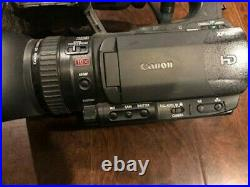 Canon Professional Digital Video Camera Xf100 with extender extra batteries mic