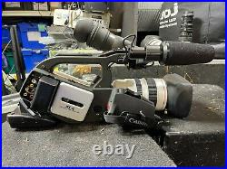 Pair of Canon XL2 digital professional camcorders with accessories and cases
