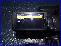 Sony FDR-AX1 Digital 4K UHD Professional Handycam + Sony Vegas Pro 14 and Extras